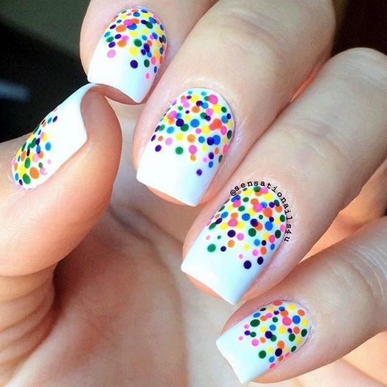 Adorable-vibrant-colors-polka-dots-on-white-base-nail-art