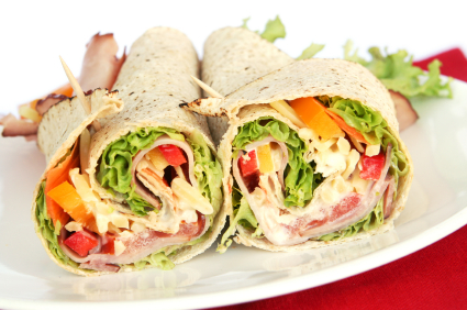 Ham wrap sandwich with salad and mayonnaise.