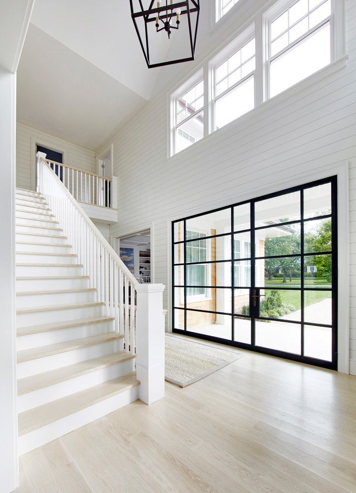 this-hamptons-home-is-a-playground-for-adults-and-kids-alike-hamptons-beach-house-bright-main-floor-59515c9f44642b1236ba30bb-w1000_h1000
